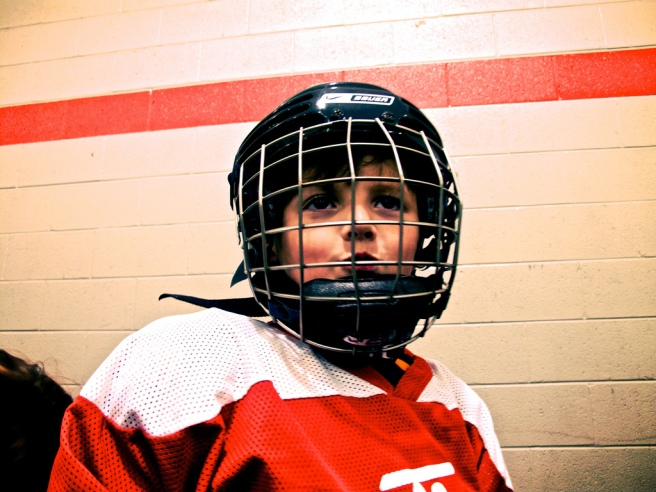 child in hockey helmet