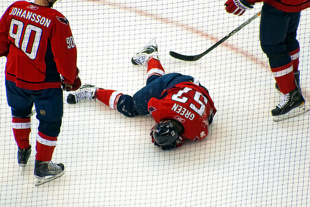 April 23, 2011:  Washington Capitals defenseman Mike Green (#52) lays on the ice after being hit in the head with the puck during Game Five of the Eastern Conference Quarterfinals NHL playoff series at Verizon Center against the New York Rangers.