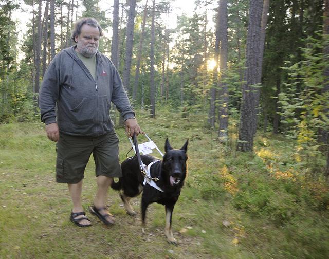 Man walking service dog