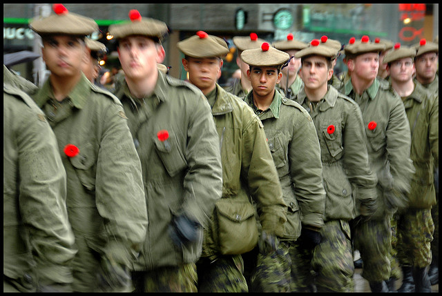 Soldiers in uniform with poppies