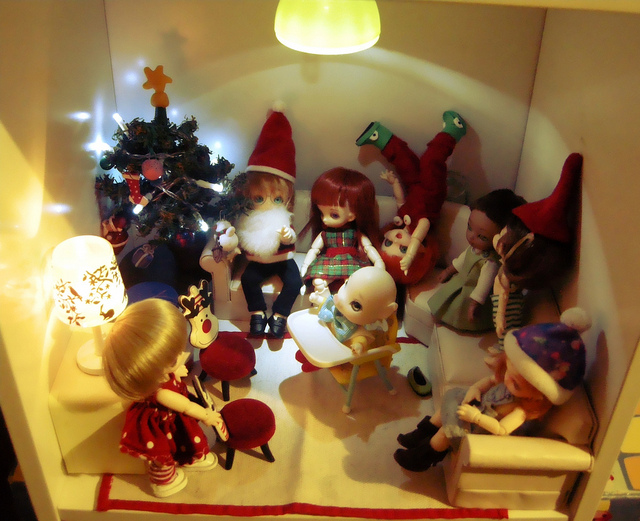 doll house figures celebrating christmas