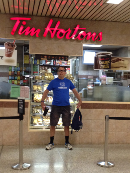 Rob in front of Tim Hortons – a Canadian favourite for coffee lovers