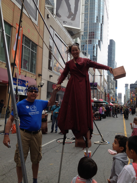 Rob with a street performer at Buskerfest in front of Yonge-Dundas Square