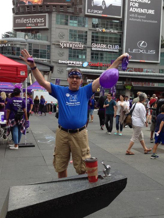 Rob promoting epilepsy awareness at Yonge-Dundas square