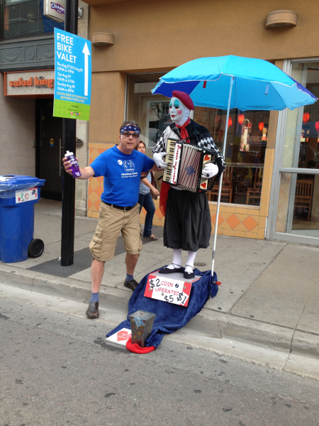 Rob poses with a street performer at BuskerFest