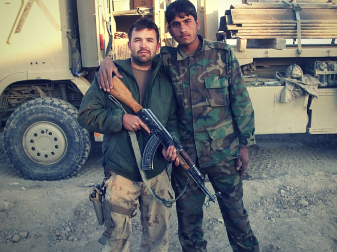 CORPORAL MACDONALD WITH AN AFGHAN NATIONAL