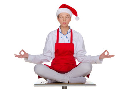 woman in santa claus hat meditating