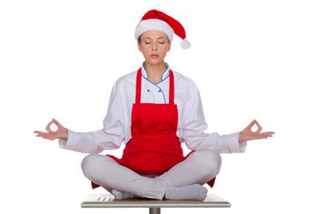 woman in santa claus hat meditating