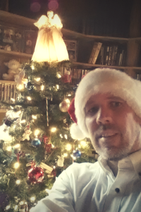 Mark Koning takes a selfie by his Christmas tree
