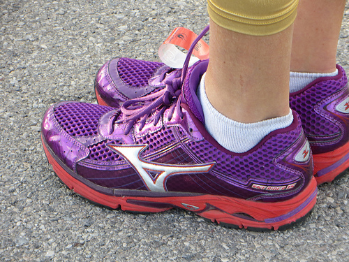 women standing in running shoes