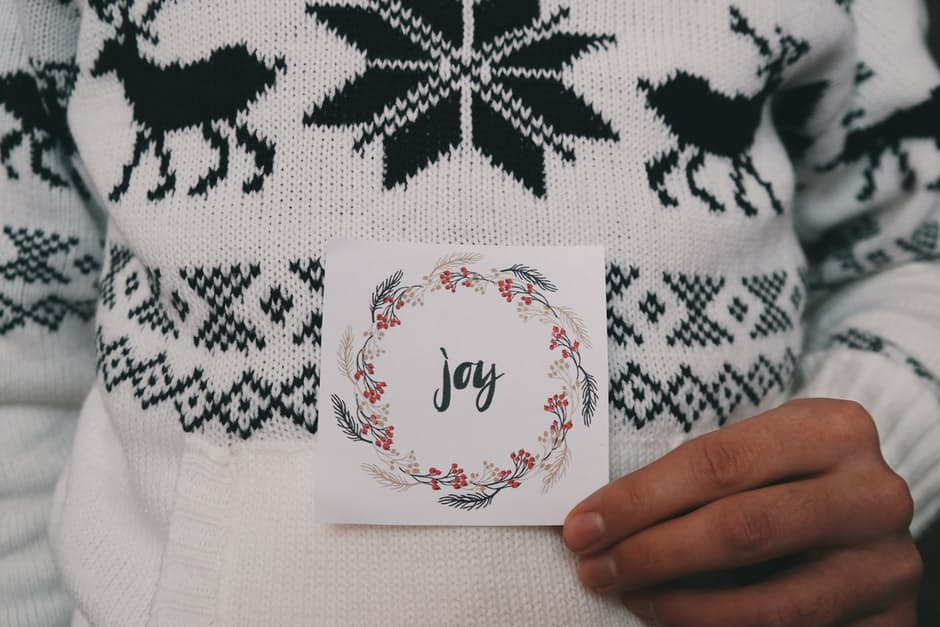 Person holding a joy card