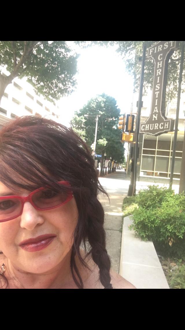 Shelly Trammel standing outside her church