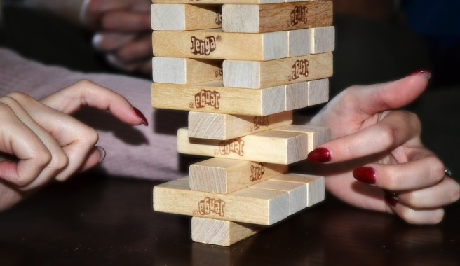 Woman plays Jenga game