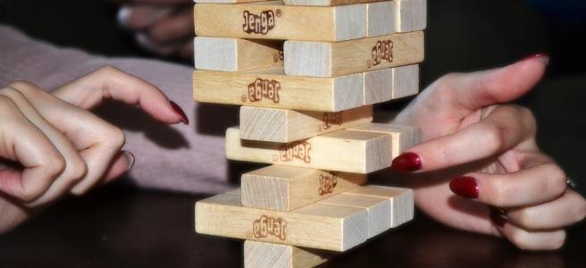 Woman plays Jenga game