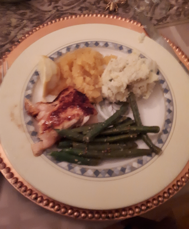 a plate with green beans, pork dressed with homemade ketchup, squash and potatoes