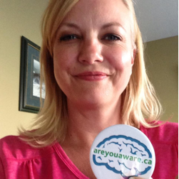 Tonya Flaming holds up an #areyouaware button
