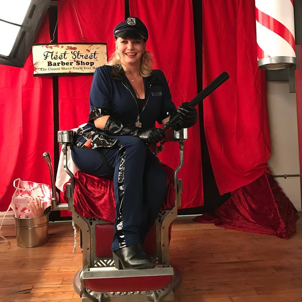 Tanya Flaming dressed as a cop, red background
