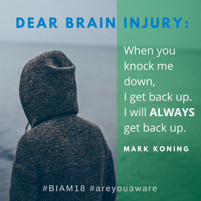Dear Brain Injury, when you knock me down I get back up. I will ALWAYS get back up. - Mark Koning Person wearing a grey hoodie, from the back, looking at the ocean