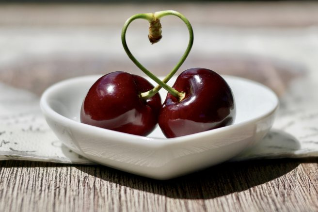 2 Cherries in a heart shaped saucer