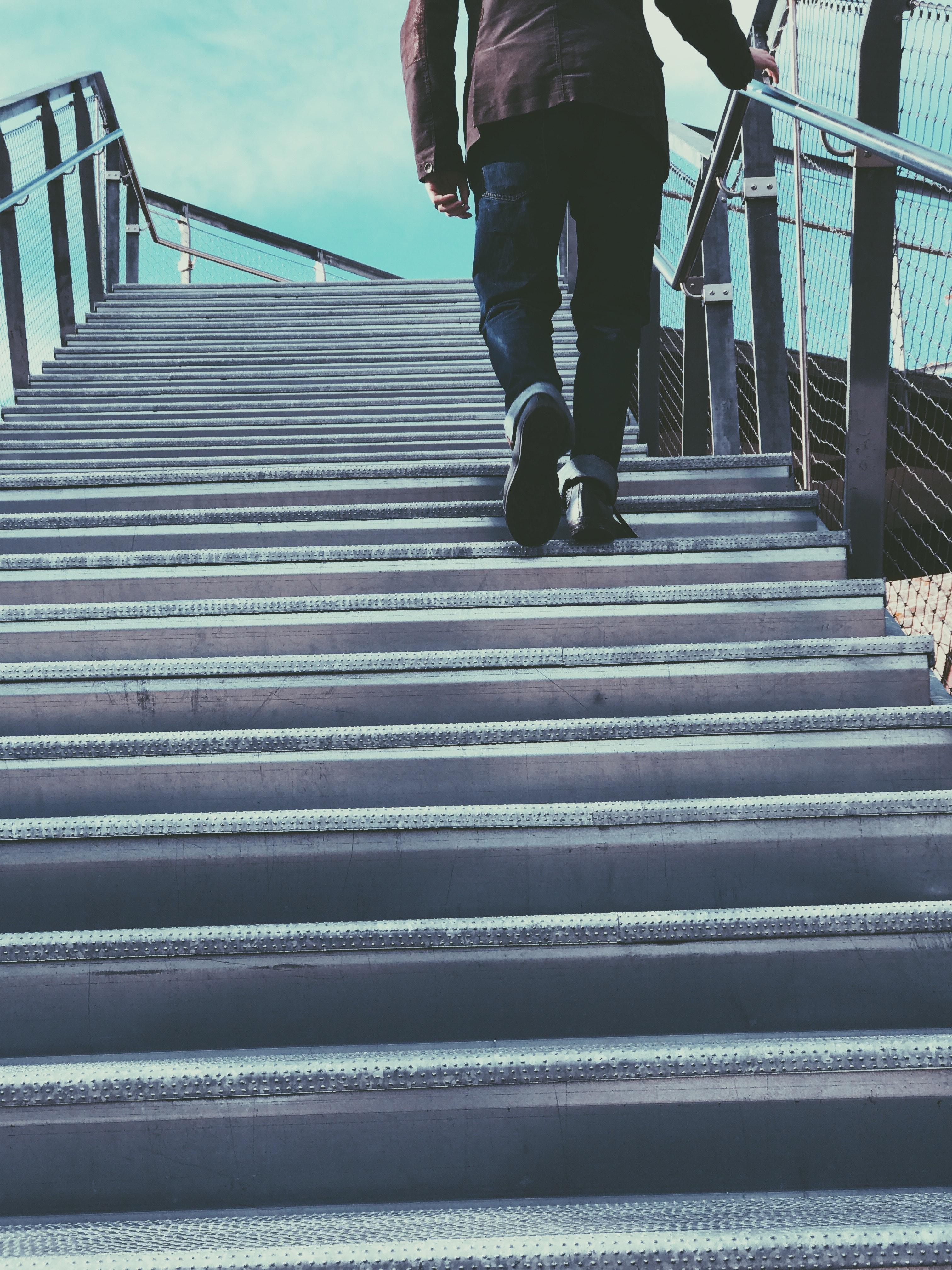 Man walking on grey stairs